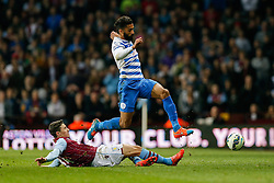 Armand Traore of QPR is tackled by Matthew Lowton of Aston Villa - Photo mandatory by-line: Rogan Thomson/JMP - 07966 386802 - 07/04/2015 - SPORT - FOOTBALL - Birmingham, England - Villa Park - Aston Villa v Queens Park Rangers - Barclays Premier League.