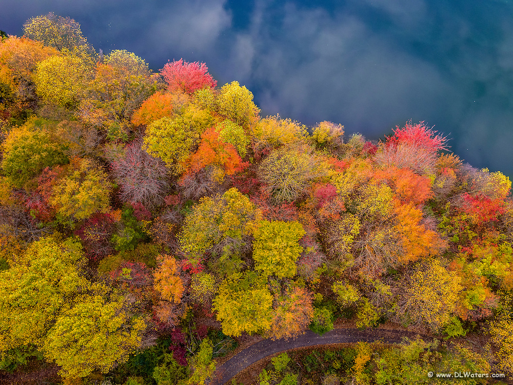 Aerial photograph of fall color and reflections of clouds in Centennial Lake Park at Ellicott City, MD.