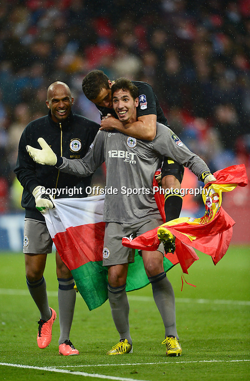 11th May 2013 - The FA Cup Final  - Manchester City v Wigan Athletic - Joel Robles of Wigan Athletic celebrates with Ali Al-Habsi - Photo: Marc Atkins / Offside.