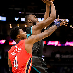 Apr 3, 2019; New Orleans, LA, USA;  Charlotte Hornets guard Kemba Walker (15) shoots over New Orleans Pelicans guard Elfrid Payton (4) during the first quarter at the Smoothie King Center. Mandatory Credit: Derick E. Hingle-USA TODAY Sports
