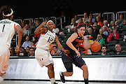 February 20, 2014: Brianna Butler #13 of Syracuse in action during the NCAA basketball game between the Miami Hurricanes and the Syracuse Orange at the Bank United Center in Coral Gables, FL. The Orange defeated the Hurricanes 69-48.