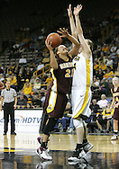 25 JANUARY 2007: Minnesota forward/center Ashley Ellis-Milan (21) tries to make a shot around Iowa center Megan Skouby (44) in Iowa's 80-78 overtime loss to Minnesota at Carver-Hawkeye Arena in Iowa City, Iowa on January 25, 2007.