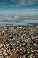 Aerial over suburban tract housing neighborhood communities and the Sacramento - San Joaquin River Delta, Antioch, California
