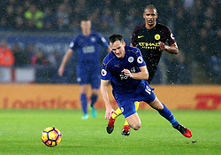 Andy King of Leicester City slips on the wet surface - Mandatory by-line: Robbie Stephenson/JMP - 10/12/2016 - FOOTBALL - King Power Stadium - Leicester, England - Leicester City v Manchester City - Premier League