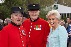 © Licensed to London News Pictures. 21/05/2012. London, England. Presenter Angela Rippon with two Chelsea Pensioners. RHS Celsea Flower Show 2012 - Press Day. Photo credit: Bettina Strenske/LNP
