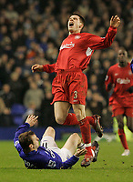 Photo: Dave Howarth.<br /> Everton v Liverpool. The Barclays Premiership. 28/12/2005. Liverpool's Steve Finnan is brought down by Everton's Tim Cahill