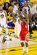 Golden State Warriors forward Kevin Durant (35) takes the ball to the basket against the Houston Rockets during Game 3 of the Western Conference Finals at Oracle Arena in Oakland, Calif., on May 20, 2018. (Stan Olszewski/Special to S.F. Examiner)