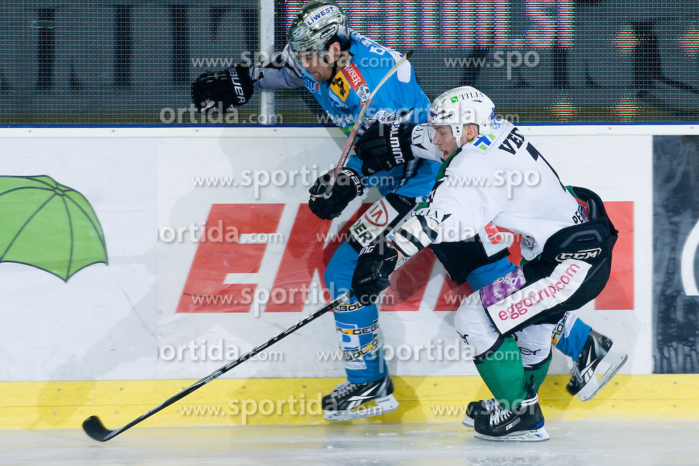 Domen Vedlin (HDD Tilia Olimpija, #7) vs Patrick Leahy (EHC Liwest Black Wings Linz, #71) during ice-hockey match between HDD Tilia Olimpija and EHC Liwest Black Wings Linz in 37th Round of EBEL league, on Januar 9, 2011 at Hala Tivoli, Ljubljana, Slovenia. (Photo By Matic Klansek Velej / Sportida.com)