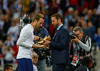 Football - 2018 / 2019 UEFA Nations League A - Group Four: England vs. Spain<br /> <br /> Harry Kane (England) receives his golden boot from England Manager Gareth Southgate, at Wembley Stadium.<br /> <br /> COLORSPORT/DANIEL BEARHAM