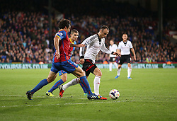 Fulham's Dimitar Berbatov takes the ball away from Crystal Palace's Mile Jedinak - Photo mandatory by-line: Robin White/JMP - Tel: Mobile: 07966 386802 21/10/2013 - SPORT - FOOTBALL - Selhurst Park - London - Crystal Palace V Fulham - Barclays Premier League
