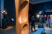 Figure (Sunion) by Dame Barbara Hepworth with Upright Motive no 8 by Henry Moore  in the background - Christie's Modern British and Irish Art Sale which will take place on 19 November 2014. Featuring 35 lots, the auction includes  examples of 20th century British sculpture and painting, such as: John Duncan Fergusson's Poise (estimate: £80,000-120,000); six paintings by L.S. Lowry, led by Coal Barge (estimate: £700,000-1,000,000);  Euan Uglow's masterpiece entitled Three In One (estimate: £500,000-800,000; Figure (Sunion) by Dame Barbara Hepworth (estimate: £600,000-800,000); and sculpture by leading artists of the genre including Henry Moore, Lynn Chadwick, Dame Elisabeth Frink, and Naum Gabo.