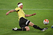 Ben Sigmund of the Phoenix kicks the ball during the A-League - Wellington Phoenix v Western Sydney football match at Westpac Stadium in Wellington on Sunday the 10 April 2016. Copyright Photo by Marty Melville / www.Photosport.nz
