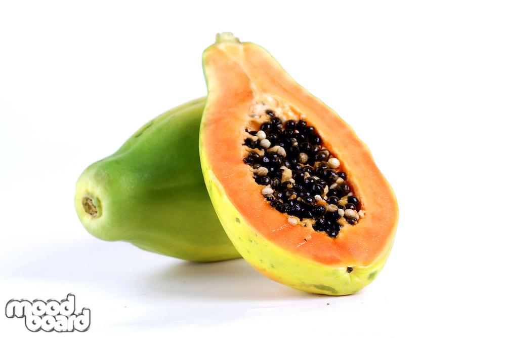 Halved papaya on white background
