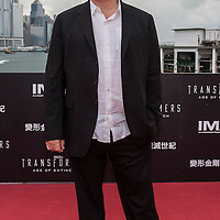"arrives at the worldwide premiere screening of ""Transformers: Age of Extinction""at the  on June 19, 2014 in Hong Kong, Hong Kong."