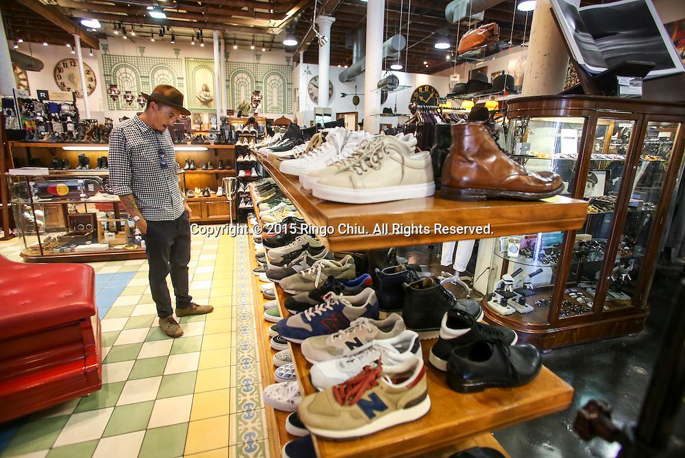 A customer in American Rag.(Photo by Ringo Chiu/PHOTOFORMULA.com)