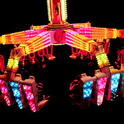 Carnival-goers enjoy a late-night thrill on a high-swinging ride at the Riverside County Fair and National Date Festival, in Indio California on February 13, 2009. Photo by Jen Klewitz