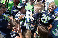 (Gabe Green | The Daily World)<br /> <br /> Delisa &ldquo;Mama&rdquo; Lynch, mother of Seattle Seahawks running back Marshawn Lynch, laughs after Jordan David Kuczynski, 2, sneezed while holding him as she signed autographs for fans at the Ocean Shores Seahawks Fan Fest and 2015 Season Kickoff Celebration in the Ocean Shores Convention Center Saturday afternoon.