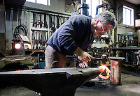 Blacksmith Steve Fontanini fashions a custom horseshoe at his shop in Hoback. Fontanini, who used to make a living out of creating thousands of horseshoes, now only makes custom shoes upon request.