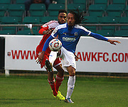 Dover midfielder Ricky Modeste shields the ball from Chris Sessegnon during the FA Trophy match between Whitehawk FC and Dover Athletic at the Enclosed Ground, Whitehawk, United Kingdom on 12 December 2015. Photo by Bennett Dean.