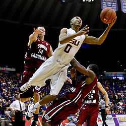 Jan 16, 2013; Baton Rouge, LA, USA; LSU Tigers guard Charles Carmouche (0) collides with South Carolina Gamecocks guard Brenton Williams (1) as forward Laimonas Chatkevicius (14) defends from behind on the play during the second half of a game at the Pete Maravich Assembly Center. South Carolina defeated LSU 82-73. Mandatory Credit: Derick E. Hingle-USA TODAY Sports