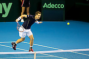 Andy Murray of Great Britain plays a volley at the net during the 2016 Davis Cup Semi Final between Great Britain and Argentina at the Emirates Arena, Glasgow, United Kingdom on 17 September 2016. Photo by Craig Doyle.