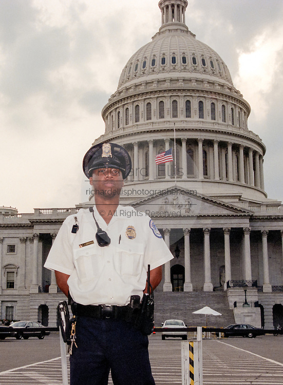 US Capitol Police officer guards a closed US Capitol after a shooting erupted on Capitol Hill July 24, 1998 in Washington, DC. Two US Capitol police officers were killed in the incident, one person wounded and the lone gunmen was wounded and taken into custody.