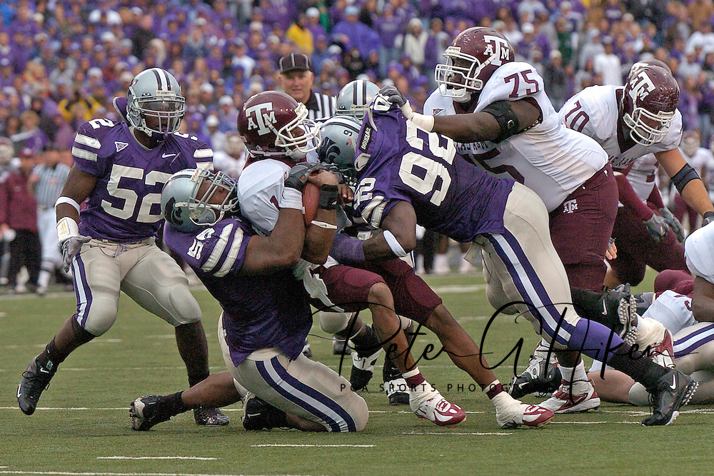 Texas A&M quarterback Reggie McNeal (C) is sacked for an 11-yard loss by Kansas State's Quintin Echols (56) and Tearrius George (92), during the the fourth quarter at KSU Stadium in Manhattan, Kansas, October 22, 2005.  The Aggies beat K-State 30-28.