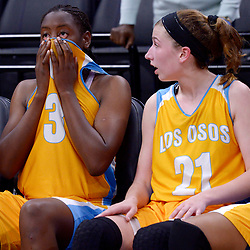 Los Osos' Destiny Okomkwo (3) wipes her face as teammate Peyton Van Soest (21) looks on as Sacramento West Campus defeated Los Osos 63-55 during a CIF State Division IV final at the Golden 1 Arena in Sacramento, Calif., on Saturday, March, 25, 2017.