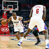 07 November 2016: Los Angeles Clippers guard Chris Paul (3) drives past Detroit Pistons guard Ish Smith (14) on a screen set by Los Angeles Clippers center DeAndre Jordan (6) during the LA Clippers 114-82 victory over the Detroit Pistons, at the Staples Center, Los Angeles, California, USA.