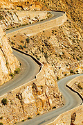 The winding, meandering mountain road is famous for driving and runs inside the Dades Gorge and through the Dades Valley like a river, Southern Morocco 2016-05-13.<br /> <br /> This main road known as being the 'road of a thousand kasbahs' stretches from Ouarzazate to Tinghir, curving it's way through gorges and stunning arid landscapes which are naturally eroded by the winds from the Sahara desert. <br /> <br /> The region offers stunning trekking, hiking, driving and cyclying routes throughout the gorge, oasis palmeries which are built alongside the Oued Dades (Dades river) and the crumbling derelict kasbahs.