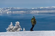 A snowboarder rides into Lake Tahoe as viewed from Diamond Peak ski resort in Incline Village after a snow storm.