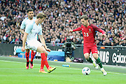 Portugal midfielder, Adrien Silva (23) taking on England midfielder, Eric Dier (17) during the Friendly International match between England and Portugal at Wembley Stadium, London, England on 2 June 2016. Photo by Matthew Redman.