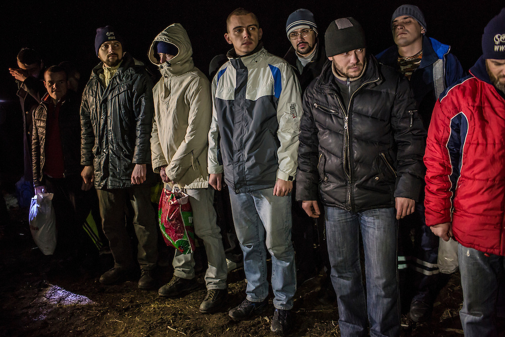 NOVOTOSHKIVSKE, UKRAINE - FEBRUARY 21: Ukrainian prisoners of war are held by pro-Russian rebels before a prisoner exchange on February 21, 2015 in Novotoshkivske, Ukraine. Ukrainian forces withdrew from the strategic and hard-fought town after being effectively surrounded by pro-Russian rebels, though fighting has caused widespread destruction.