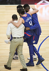 October 21, 2017 - Los Angeles, California, U.S - Milos Teodosic #4 of the Los Angeles Clippers is helped off the court with a left foot injury during their first regular season game against the Phoenix Suns on Saturday October 21, 2017 at the Staples Center in Los Angeles, California. Clippers defeat Suns, 130-88. (Credit Image: © Prensa Internacional via ZUMA Wire)