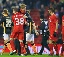 LIVERPOOL, ENGLAND - Wednesday, January 20, 2016: Liverpool's manager Jürgen Klopp hugs Jon Flanagan after the 3-0 victory over Exeter City during the FA Cup 3rd Round Replay match at Anfield. (Pic by David Rawcliffe/Propaganda)