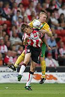 Photo: Lee Earle.<br /> Southampton v West Bromwich Albion. Coca Cola Championship. 12/08/2006. Saint's Grzegorz Rasiak (f) is challenged by Steve Watson.