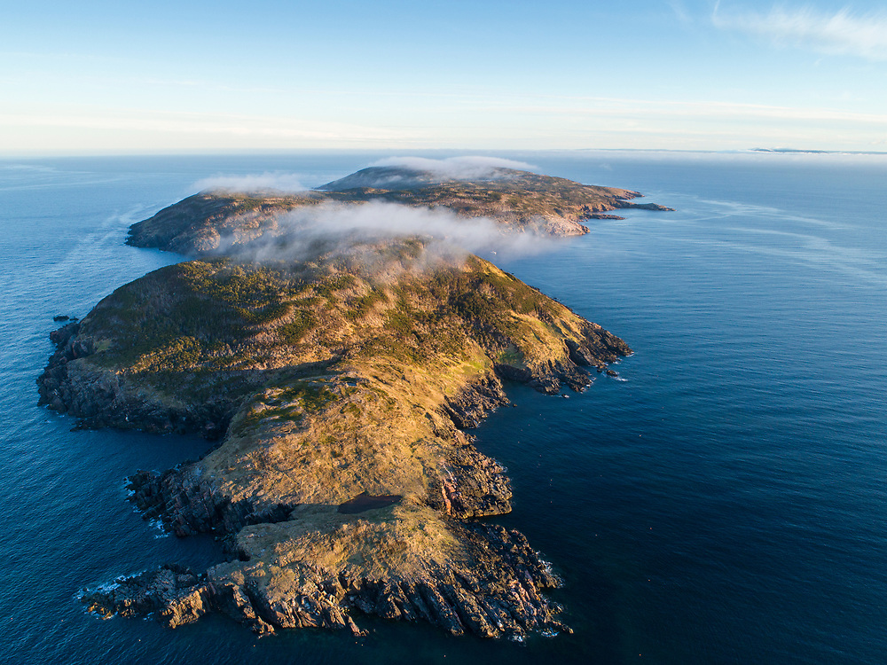 Canada, Nova Scotia, Aerial view of windswept St. Paul Island in Cabot Strait at sunset on summer evening