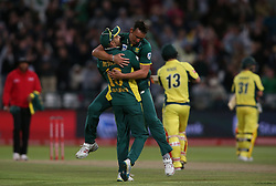 South African captain Faf du Plessis congratulates Kyle Abbott of South Africa for getting Matthew Wade of Australia wicket during the 5th ODI match between South Africa and Australia held at Newlands Stadium in Cape Town, South Africa on the 12th October  2016<br /> <br /> Photo by: Shaun Roy/ RealTime Images