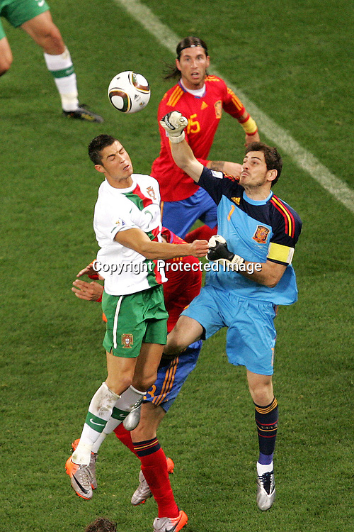 Cristiano Ronaldo of Portugal battles with Iker Casillas of Spain  during the FIFA World Cup 2010 last 16 match between Spain and Portugal held at The Cape Town Stadium in Green Point, Cape Town, South Africa on the 29th June 2010<br /> <br /> <br /> Photo by Ron Gaunt/SPORTZPICS