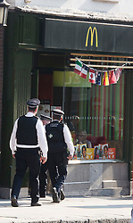 © London News Pictures. 26/07/2012. London, UK. Police officers entering a McDonalds restaurant on Fleet Street, London after leaving there police vehicle on double yellow lines.  Staff at the McDonalds on Fleet Street confirmed that police had not been called to the building and that they were there to use the facilities and eat. Photo credit : LNP