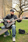Windsor, Ontario. 2012. Rockin' Robbee plays guitar in the Senator Croll Park. He was making a field recording for a documentary porject about Occupy Windsor.