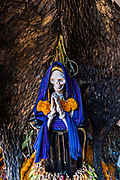 A shrine and offerings to Santa Muerte inside the La Casa De La Santa Muerte or House of the Saint of the Dead November 1, 2017 in Santa Ana Chapitiro, Michoacan, Mexico.