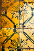 Faded tiles on building on Rua Vitor Cordon, Lisbon