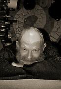 man with grey beard looking lovingly into the camera