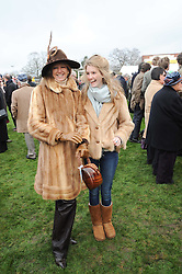 Left to right, FIONA SANGSTER and her daughter ELLA MAY SANGSTER at the Hennessy Gold Cup 2010 at Newbury Racecourse, Berkshire on 27th November 2010.
