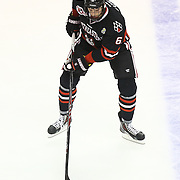 Mike Gunn #6 of the Northeastern Huskies with the puck during The Beanpot Championship Game at TD Garden on February 10, 2014 in Boston, Massachusetts. (Photo by Elan Kawesch)