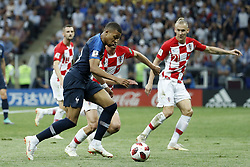 (L-R) Kylian Mbappe of France, Ivan Strinic of Croatia, Domagoj Vida of Croatia during the 2018 FIFA World Cup Russia Final match between France and Croatia at the Luzhniki Stadium on July 15, 2018 in Moscow, Russia
