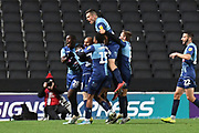 The Wycombe Wanderers players  celebrate Wycombe Wanderers forward Josh Parker (27) goal 1-2 during the EFL Trophy match between Milton Keynes Dons and Wycombe Wanderers at stadium:mk, Milton Keynes, England on 12 November 2019.