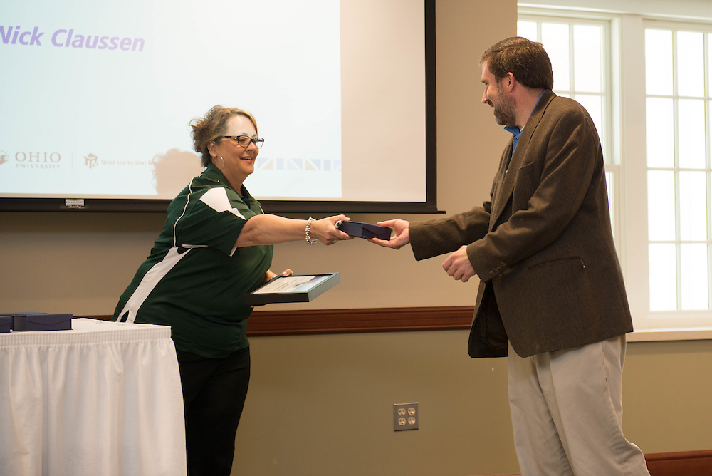 NIck Claussen, Assistant to the Vice Provost for Global Affairs for the Center of Global Studies, receives the Excellence in Internal Communications - Feature award at the Campus Communicator Network Expo in Nelson Commons on Wednesday, May 11, 2016. © Ohio University / Photo by Kaitlin Owens The Campus Communicator Network Expo in Nelson Commons on Wednesday, May 11, 2016. © Ohio University / Photo by Kaitlin Owens