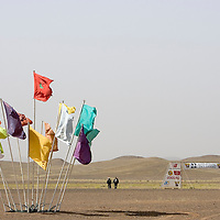 24 March 2007:  Morocco red and green national banner is raised among others flags next to the starting line the day before the beginning of the 22nd Marathon des Sables, a 6 days and 151 miles endurance race with food self sufficiency across the Sahara Desert in Morocco. Each participant must carry his, or her, own backpack containing food, sleeping gear and other material.